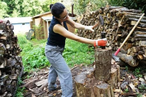 Using a hammer and wedge to hit the log before splitting