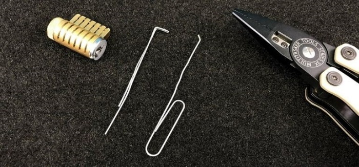 Pick A Lock With A Tool Box With A Paperclip
