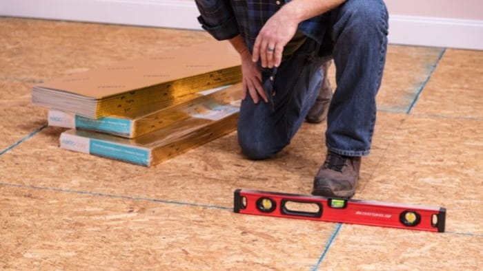 Use a 4-foot level to check the floor level