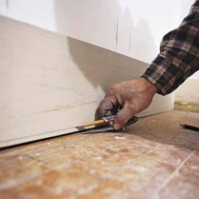 Use a compass and a pencil to scribe the baseboard