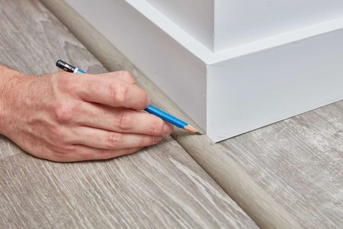 measure and cut the quarter round to fit the wall and the flooring